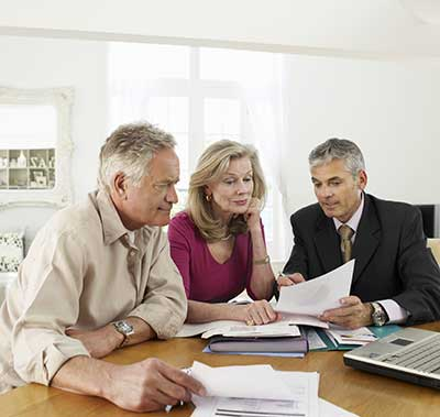 Clients meeting with life settlement broker for advisors